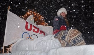 In this Feb. 27, 2014 photo, Olympic luge Bronze medallist Erin Hamlin rides in a parade on Main St. in Remsen, N.Y. (AP Photo/The Syracuse Newspapers, Scott Schild) NO SALES