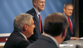 Illinois Republican primary gubernatorial candidate Bruce Rauner, standing center, waits before the start of a debate with State Treasurer Dan Rutherford, right, State Sen. Bill Brady, second from right and State Sen. Kirk Dillard, Wednesday, March 5, 2014, in Chicago. (AP Photo/Charles Rex Arbogast)