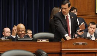House Oversight and Government Reform Committee Chairman Rep. Darrell E. Issa prepares to leave as ranking member Rep. Elijah E. Cummings begins his statement Wednesday at a hearing at which former Internal Revenue Service official Lois G. Lerner invoked her constitutional right not to incriminate herself. (associated press)
