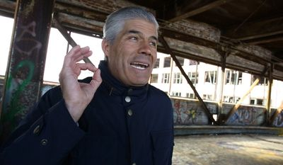 "In this photo taken on Jan. 12, 2014, Fernando Palazuelo, new owner of the Packard Motor Car Co. property in Detroit, Mich., talks about his plans for the property's bridge over East Grand Blvd. The Detroit Free Press reported, Wednesday, March 5, 2014, that Dominic Cristini wants Palazuelo, the owner of the Packard car plant complex, to pay for a piece of the land that Cristini says he still technically owns. Cristini says he could make a claim of ownership over most of the property. Palazuelo, a developer from Peru, bid $405,000 for the property last year during a tax foreclosure auction. He says Cristini wants $3.5 million and calls it ""typical blackmail."" (AP Photo/Detroit News, Brian Kaufman)  DETROIT FREE PRESS OUT; HUFFINGTON POST OUT; MAGS OUT; MANDATORY CREDIT"