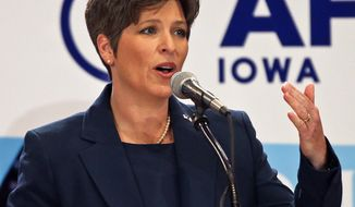** FILE ** This Oct. 23, 2013, file photo shows state Sen. Joni Ernst during a Senate debate in Des Moines, Iowa. (AP Photo/The Des Moines Register, Bill Neibergall)