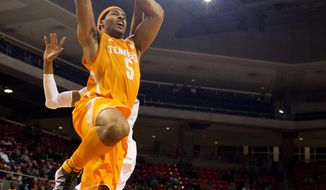Tennessee Volunteers guard-forward Jarnell Stokes (5) is fouled by Auburn Tigers center Asauhn Dixon-Tatum (0) while going up for a dunk during the first half of the NCAA men's basketball game on Wednesday, March 5, 2014, at Auburn Arena in Auburn, Ala. (AP Photo/Opelika-Auburn News/Albert Cesare)