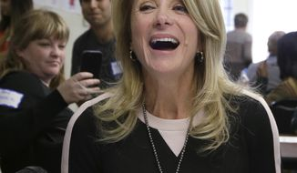 Texas Sen. Wendy Davis, D-Fort Worth, laughs as she speaks to supporters at her campaign headquarters Tuesday, March 4, 2014, in Fort Worth, Texas. Now the Texas governor's race really begins and Davis insists that, yes, it'll be a race. (AP Photo/LM Otero)