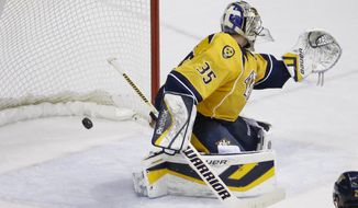 Nashville Predators goalie Pekka Rinne, of Finland, reaches for a goal by Pittsburgh Penguins' Chris Kunitz in the third period of an NHL hockey game Tuesday, March 4, 2014, in Nashville, Tenn. The Penguins won 3-1. (AP Photo/Mark Humphrey)