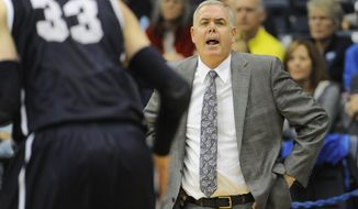 BYU head coach Dave Rose yells from the sideline during the second half of an NCAA college basketball game against San Diego, Saturday, March 1, 2014, in San Diego. (AP Photo/Denis Poroy)