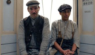 """This image released by Fox Searchlight shows Ralph Fiennes, left, and Tony Revolori in """"The Grand Budapest Hotel ."""" (AP Photo/Fox Searchlight)"""