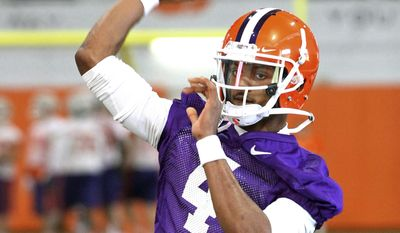 Clemson quarterback Deshaun Watson throws a pass on the first day of NCAA college football spring practice for the team, Wednesday, March 5, 2014, in Clemson, S.C. (AP Photo/Anderson Independent-Mail, Mark Crammer) GREENVILLE OUT  SENECA OUT