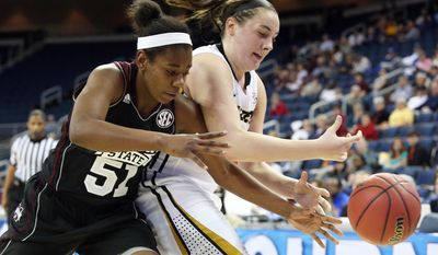 Mississippi State guard Savannah Carter (51) knocks the ball away from Missouri forward Kayla McDowell (20) in the second half of a first-round women's Southeastern Conference tournament NCAA college basketball game Wednesday, March 5, 2014, in Duluth, Ga. Mississippi State  won 73-70. (AP Photo/Jason Getz)