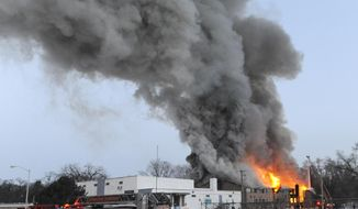 Firefighters battle a large fire at an apartment building in Detroit on March 5, 2014. There were no immediate reports of any deaths caused by the fire at the Jason Manor Apartments, which broke out at about 6 a.m. Four people were taken to hospitals for treatment, Detroit Fire Commissioner Jonathan Jackson said. (Associated Press/Detroit News, David Coates)