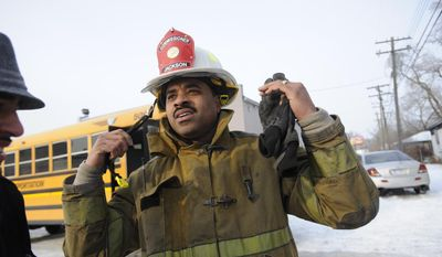 Detroit Fire Commissioner Jonathan Jackson speaks to the media at the scene of a large fire at an apartment building in Detroit, Wednesday, March 5, 2014. There were no immediate reports of any deaths caused by the fire at the Jason Manor Apartments, which broke out at about 6 a.m. Four people were taken to hospitals for treatment, Jackson said. (AP Photo/Detroit News, David Coates)  DETROIT FREE PRESS OUT; HUFFINGTON POST OUT; MAGS OUT; MANDATORY CREDIT