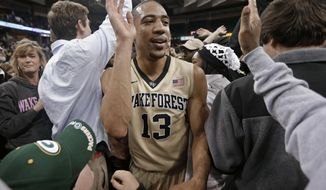Wake Forest's Coron Williams (13) celebrates with fans after an NCAA college basketball game against Duke in Winston-Salem, N.C., Wednesday, March 5, 2014. Wake Forest won 82-72. (AP Photo/Chuck Burton)