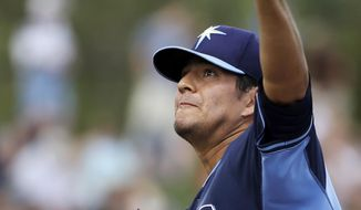 Tampa Bay Rays pitcher Cesar Ramos delivers a warm-up throw in the second inning of an exhibition baseball game against the New York Yankees, Wednesday, March 5, 2014, in Port Charlotte, Fla. (AP Photo/Steven Senne)