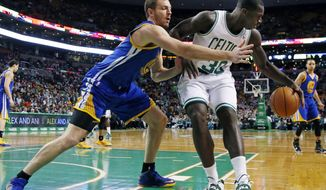 Golden State Warriors forward David Lee (10) reaches to defend against Boston Celtics power forward Brandon Bass (30) in the first half of an NBA basketball game in Boston, Wednesday, March 5, 2014. (AP Photo/Elise Amendola)