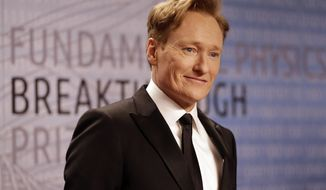 """FILE - In this Dec. 12, 2013, file photo, talk show host Conan O'Brien arrives for the Breakthrough Prize in Life Sciences awards in Moffett Field, Calif. O'Brien announced Tuesday, March 4, 2014, on his TBS talk show """"Conan"""" that he's hosting this year's MTV Movie Awards. The annual movie celebration that honors winners with popcorn-shaped trophies is scheduled for April 13, 2014 at the Nokia Theatre in downtown Los Angeles. (AP Photo/Ben Margot, file)"""
