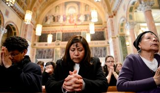 Congregants pray as Cardinal Donald Wuerl leads noon mass on Ash Wednesday at the Cathedral of Saint Matthew the Apostle, Washington, D.C., Wednesday, March 5, 2014. Ash Wednesday marks the beginning of a 40-day liturgical period of prayer and fasting or abstinence. (Andrew Harnik/The Washington Times)
