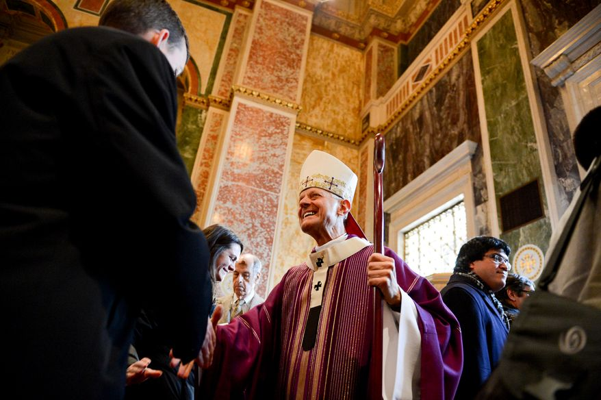 Cardinal Donald Wuerl greets congregants after leading noon mass on Ash Wednesday at the Cathedral of Saint Matthew the Apostle, Washington, D.C., Wednesday, March 5, 2014. Ash Wednesday marks the beginning of a 40-day liturgical period of prayer and fasting or abstinence. (Andrew Harnik/The Washington Times)