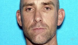 FILE - This undated image provided by the Mesquite Police Department shows Daniel Runyon. The 41-year-old ex-convict from Utah is due for sentencing on Wednesday March 5, 2014,  in Las Vegas, on a reduced charge in a shooting that wounded a Mesquite police officer last year. (AP Photo/Mesquite Police Department, File)