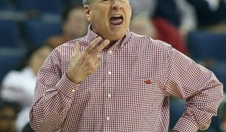Arkansas head coach Tom Collen yells to his players in the first half of a first-round women's Southeastern Conference tournament NCAA college basketball game against the Mississippi Wednesday, March 5, 2014, in Duluth, Ga.  (AP Photo/Jason Getz)