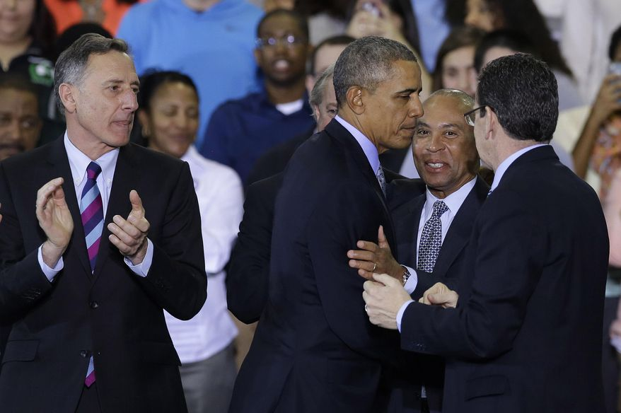 President Barack Obama greets Massachusetts Gov. Deval Patrick as Vermont Gov. Peter Shumlin, left, and Connecticut Gov. Dannel P. Malloy, right, look on after Obama spoke about the minimum wage during an event in Kaiser Hall on the Central Connecticut State University campus in New Britain, Conn., Wednesday, March 5, 2014. (AP Photo/Stephan Savoia)