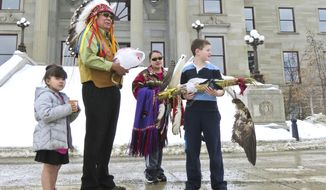 James St. Goddard, spiritual leader of the Blackfeet Confederacy, speaks out against the hunting of pregnant bison by other tribes on the steps of the Montana state capitol building on Tuesday, March 4, 2014. (AP Photo/The Independent Record, Thom Bridge)