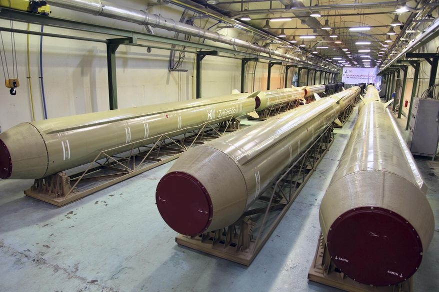 This photo released on Wednesday, March 5, 2014 by the Iranian Defense Ministry, purports to show Qadr and Qiam missiles in an undisclosed location in Iran. Iran's powerful Revolutionary Guard on Wednesday said it had acquired missiles with multiple warheads, the latest armaments advance to be claimed by the Islamic Republic. At a ceremony Wednesday, Defense Minister Hossein Dehghan presented a delivery of four types of ballistic missiles - named Qiam, Qadr H1, Fateh-110 and Persian Gulf. (AP Photo/Iranian Defense Ministry)