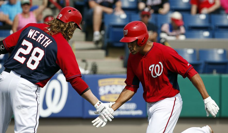 Washington Nationals' Ian Desmond, right, celebrates his solo home run with Jayson Werth in the third inning of a spring exhibition baseball game against the New York Mets, Wednesday, March 5, 2014, in Viera, Fla. (AP Photo/Alex Brandon)