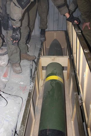 This photo released by the Israel Defense Forces shows a missile on an intercepted ship in the Red Sea Wednesday, March 5, 2014. Israeli naval forces raided a ship deep in the Red Sea early Wednesday and seized dozens of advanced rockets from Iran destined for Palestinian militants in Gaza, the military said. (AP Photo/IDF)