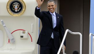 **FILE** President Obama waves before his departure on Air Force One from Bradley Air National Guard Base in East Granby, Conn., on March 5, 2014. Obama, who was heading to Boston, was in Connecticut to talk about increasing the federal minimum wage. (Associated Press)