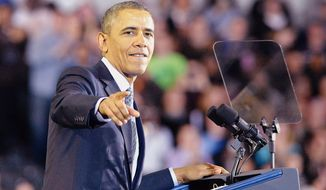 President Barack Obama talks to the crowd at Central Connecticut State University during a speech Wednesday, March 5, 2014,  about raising the minimum wage. (AP Photo/The Hour, Alex von Kleydorff)