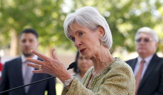 Health and Human Services Secretary Kathleen Sebelius speaks about educating people on signing up for the new national healthcare coverage plan during a news conference, on Wednesday, March 5, 2014, in Phoenix. (AP Photo/Ross D. Franklin)