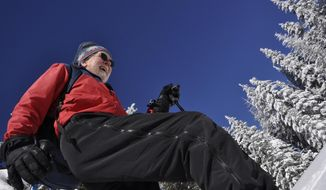 Art Bookstrom, 75, breaks trail on a cross-country skiing route he marked with orange triangles for the enjoyment of skiers who want an old-fashioned nordic skiing experience off the wide, groomed trails at Mount Spokane State Park.  (AP Photo/The Spokesman-Review, Rich Landers)