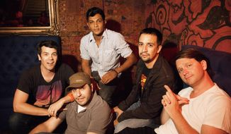 This July 26, 2012 image released by Pivot shows, from left, Anthony Veneziale, Bill Sherman, Utkarsh Ambudkar, Lin-Manuel Miranda, and Chris Sullivan of the improv hip-hop act, Freestyle Love Supreme, at the Gramercy Theater in New York. The group, which creates impromptu rap songs from single-word audience suggestions, is having a show on Thursday, March 6, 2014, recorded and then broadcast to a national audience two nights later on the millennial-seeking cable TV outlet Pivot. (AP Photo/Pivot, Mindy Tucker)