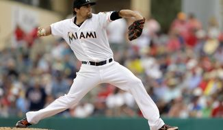 Miami Marlins starting pitcher Nate Eovaldi throws during the first inning of an exhibition spring training baseball game against the Boston Red Sox Thursday, March 6, 2014, in Jupiter, Fla. (AP Photo/Jeff Roberson)