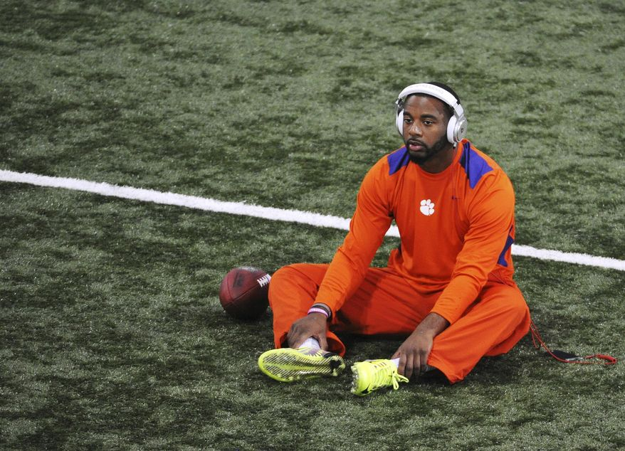 Quarterback Tajh Boyd warms up on the field during the Clemson football pro day on Thursday, March 6, 2014, in Clemson, S.C. (AP Photo/Rainier Ehrhardt)