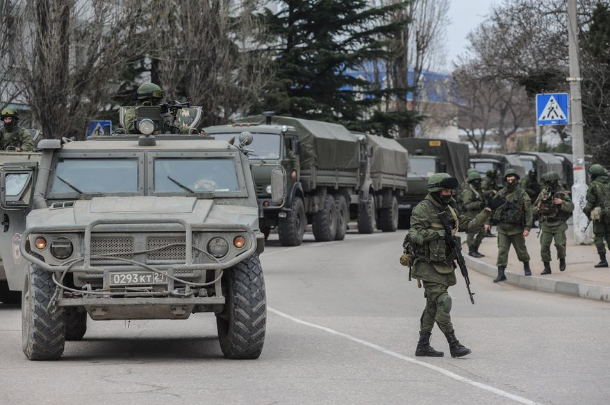 Mystery Men: Some of the troops on patrol in Crimea in unmarked uniforms are Spetsnaz, special forces who are contracted professionals rather than draftees. Russian President Vladimir Putin has built a military force capable of reclaiming territory lost in the Soviet demise. (Associated Press)