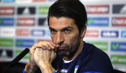 Italy's goalkeeper Gianluigi Buffon listens to a question during a press conference in Madrid, Spain, Tuesday, March 4, 2014. Italy will play Spain on Wednesday in a friendly soccer match. (AP Photo/Andres Kudacki)