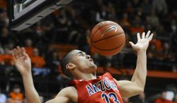 Arizona's Nick Johnson (13) scores against Oregon State during the first half of an NCAA college basketball game in Corvallis, Ore., Wednesday March 5, 2014.  (AP Photo/Greg Wahl-Stephens)