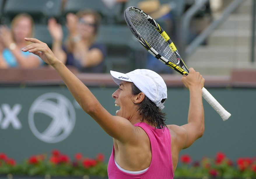 Francesca Schiavone, of Italy, celebrates after winning a game against Mona Barthel, of Germany, at the BNP Paribas Open tennis tournament, Thursday, March 6, 2014, in Indian Wells, Calif. (AP Photo/Mark J. Terrill)