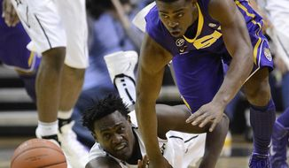 Vanderbilt forward James Siakam, left, and LSU guard Anthony Hickey, right, chase down a loose ball in the first half of an NCAA college basketball game on Thursday, March 6, 2014, in Nashville, Tenn. (AP Photo/Mark Zaleski)