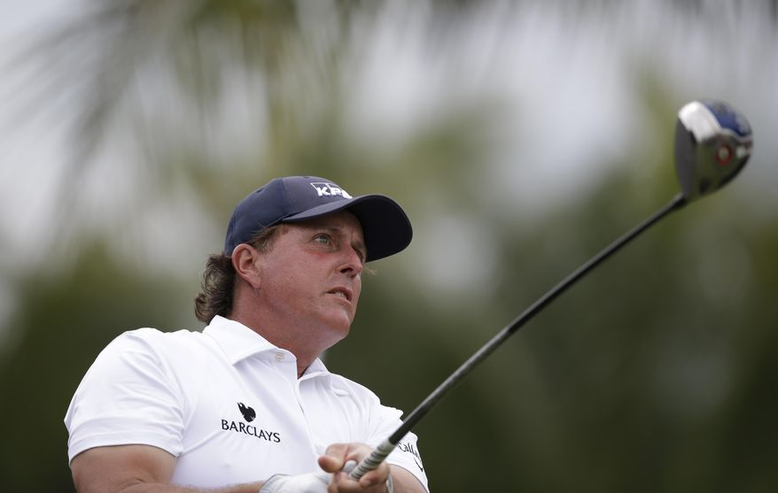 Phil Mickelson follows his shot from the 12th tee during the first round of the Cadillac Championship golf tournament Thursday, March 6, 2014 in Doral, Fla. (AP Photo/Wilfredo Lee)
