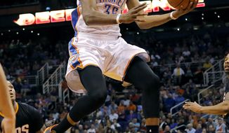 Oklahoma City Thunder forward Kevin Durant drives against the Phoenix Suns' during the first half of an NBA basketball game, Thursday, March 6, 2014, in Phoenix. (AP Photo/Matt York)