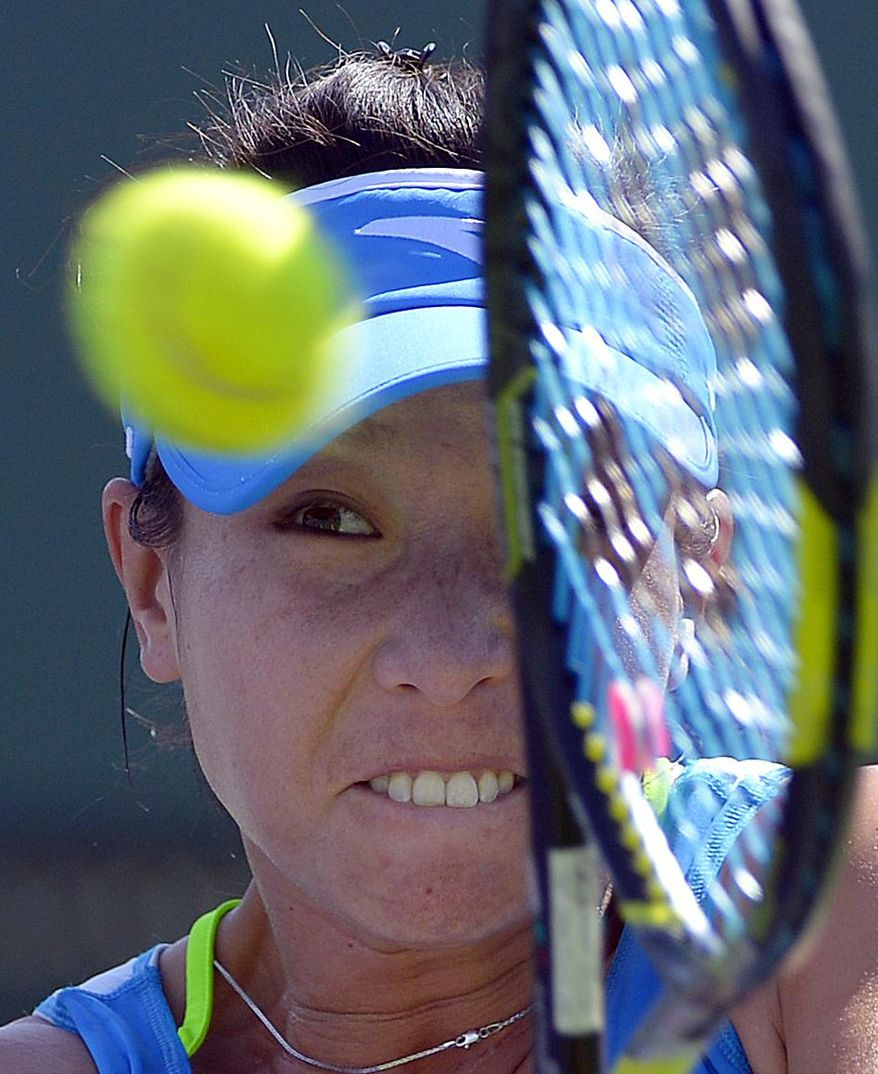 Zheng Jie, of China, returns a shot against Paula Ormaechea, of Argentina, during a first round match at the BNP Paribas Open tennis tournament, Thursday, March 6, 2014, in Indian Wells, Calif. (AP Photo/Mark J. Terrill)