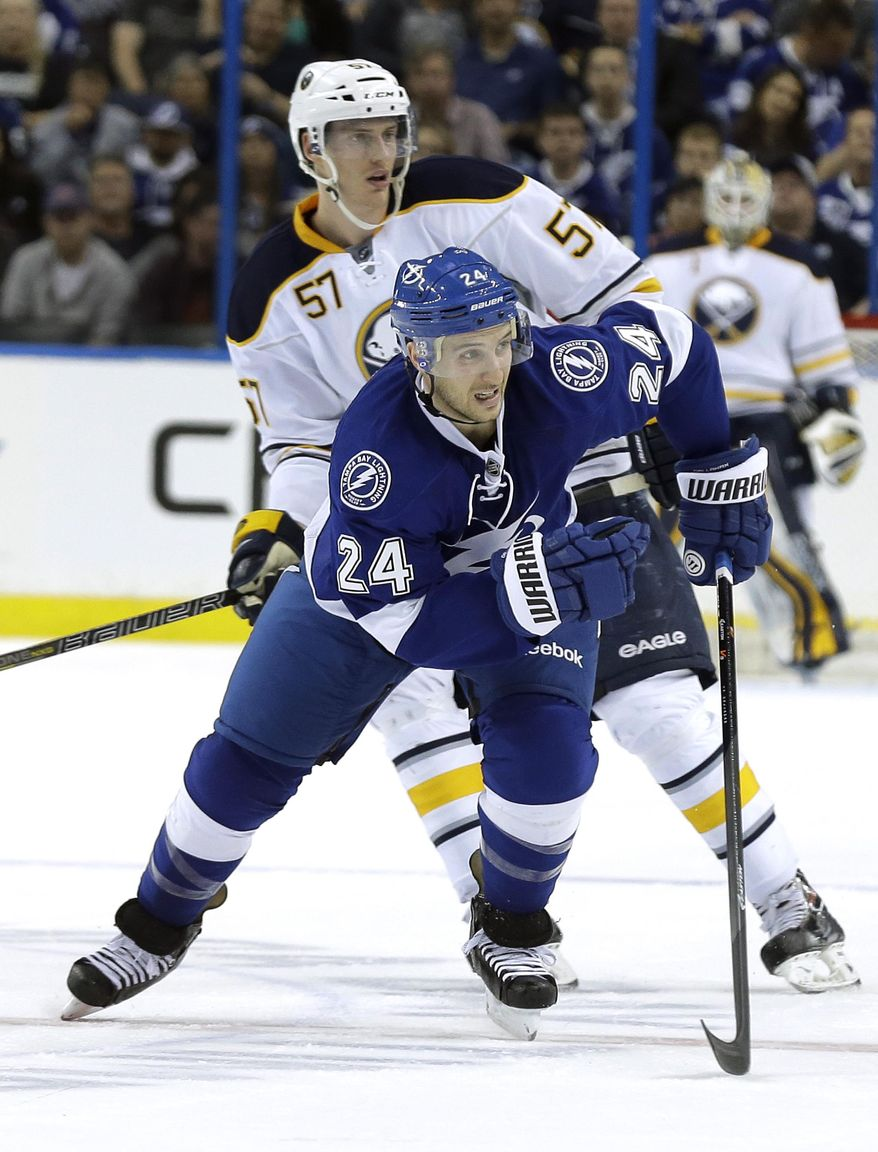 New Tampa Bay Lightning right wing Ryan Callahan (24) skates up the ice in front of Buffalo Sabres defenseman Tyler Myers (57) during the first period of an NHL hockey game Thursday, March 6, 2014, in Tampa, Fla. (AP Photo/Chris O'Meara)