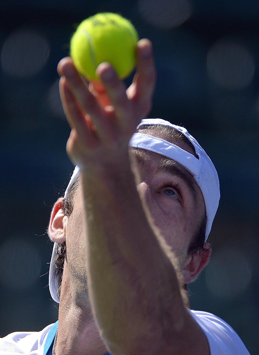 Benjamin Becker, of Germany, serves against Edouard Roger-Vasselin, of France, during a first round match at the BNP Paribas Open tennis tournament, Thursday, March 6, 2014, in Indian Wells, Calif. (AP Photo/Mark J. Terrill)