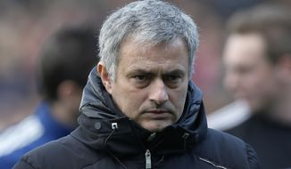 Chelsea's manager Jose Mourinho arrives at the dugout before the start of their English Premier League soccer match against Fulham, at Craven Cottage, London, Saturday, March 1, 2014. (AP Photo/Sang Tan)