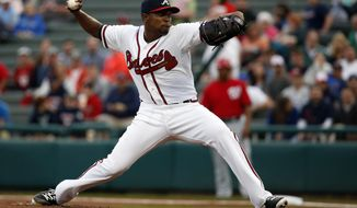 Atlanta Braves starting pitcher Julio Teheran (49) throws in the first inning of a spring exhibition baseball game against the Washington Nationals, Thursday, March 6, 2014, in Kissimmee, Fla. (AP Photo/Alex Brandon)
