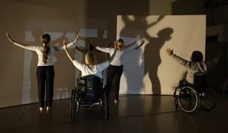 """In this Saturday, Jan. 25, 2014 photo, dancers with Karen Peterson and Dancers rehearse a dance titled """"Dance (4) 8"""" in Miami. The Miami-based company uses dancers who are disabled to enhance their performances. (AP Photo/Lynne Sladky)"""