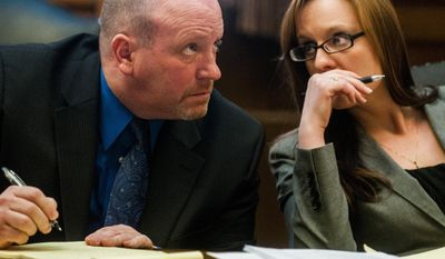 Defense Attorneys Major White and Jessica Mainprize-Hajek discuss the case during a continuation of a sentencing hearing for Mark Jones Jr. on Thursday, March 6, 2014 at Genesee Circuit Court in Flint, Mich. Jones Jr. was convicted of killing Merlyne Wray, 73,  in her Flint home when he was 14.  was robbed and shot in her home in 2010.  (AP Photo/The Flint Journal, Jake May)