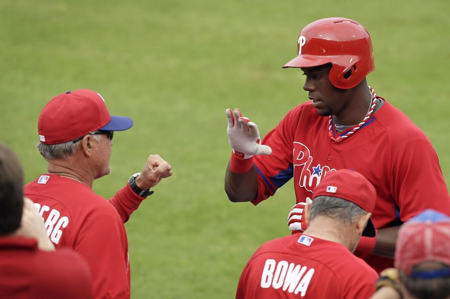 Philadelphia Phillies' John Mayberry Jr., right, celebrates with manager Ryne Sandberg after hitting a home run in the fifth inning of an exhibition baseball game against the New York Yankees Thursday, March 6, 2014, in Clearwater, Fla. (AP Photo/Charlie Neibergall)