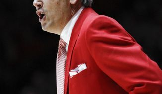 New Mexico's coach Craig Neal shouts instructions to players during the first half of an NCAA college basketball game at The Pit in Albuquerque, N.M., Wednesday, March 5, 2014. (AP Photo/Juan Antonio Labreche)